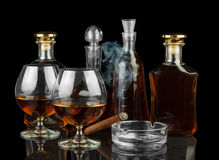 Cognac in bottles and glasses Royalty Free Stock Image