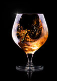 Cognac of brandewijn op een zwarte Royalty-vrije Stock Fotografie