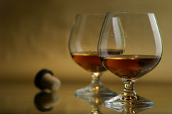 Cognac, brandy. Glass excellent brandy on a dark background Royalty Free Stock Photo