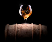 Cognac or brandy on a black. Background royalty free stock photography