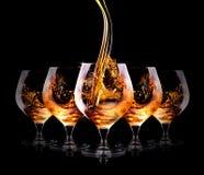 Cognac or brandy on a black Stock Photos