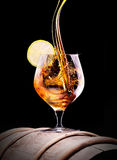 Cognac or brandy on a black Royalty Free Stock Photos