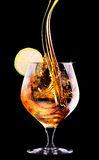 Cognac or brandy on a black Royalty Free Stock Images