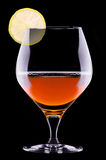 Cognac or brandy on a black Royalty Free Stock Photo