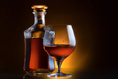 Cognac or brandy on a black Stock Photography