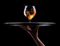 Cognac or brandy on a black Royalty Free Stock Photography