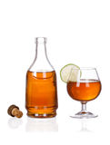 Cognac brandy bottle and glass  on white b Royalty Free Stock Photos