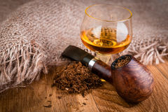 Cognac or brandy and  briar pipe Royalty Free Stock Photos