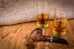 Cognac or brandy and briar pipe Stock Images