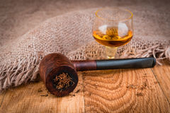 Cognac or brandy and briar pipe Stock Image