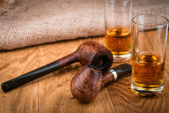 Cognac or brandy and briar pipes, men's set for friendly discussion Stock Photography