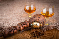 Cognac or brandy and brown pipe Royalty Free Stock Image