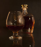 Cognac. Brandy Glass and bottle Royalty Free Stock Image