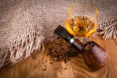 Cognac or brandy and smoking pipe Royalty Free Stock Images