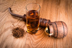 Cognac or brandy and smoking pipe Royalty Free Stock Photo