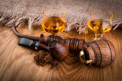 Cognac or brandy and smoking pipes Stock Photos