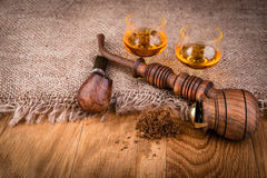 Cognac or brandy and smoking pipes Royalty Free Stock Photo