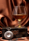 Cognac or brandy and vintage watch on chain Stock Photos