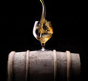 Cognac or brandy on a wooden barrel Stock Photo