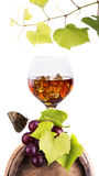 Cognac or brandy on a wooden barrel Royalty Free Stock Images