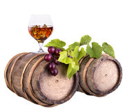 Cognac or brandy on a wooden barrel Stock Image