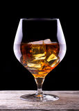 Cognac or brandy on a wooden table Stock Images