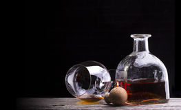 Cognac or brandy on a wooden table Stock Photography