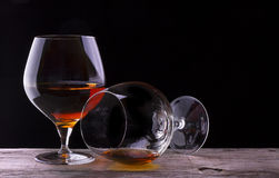 Cognac or brandy on a wooden table Royalty Free Stock Photo