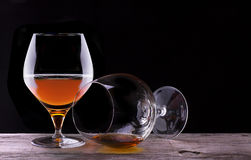 Cognac or brandy on a wooden table Stock Image