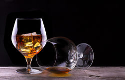 Cognac or brandy on a wooden table Royalty Free Stock Images