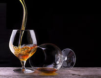 Cognac or brandy on a wooden table Royalty Free Stock Photos