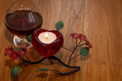 Cognac and candle Valentine`s Day Stock Image