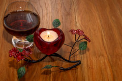 Cognac and candle Valentine`s Day Royalty Free Stock Image