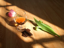 Cognac chocolate flower. Chocolate, flower and cognac drink Royalty Free Stock Photo