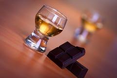 Cognac and chocolate Stock Photos