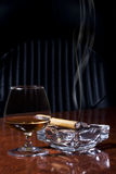 Cognac and Cigar. Snifter glass of cognac and cigar Stock Photo