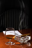 Cognac and Cigar. Snifter glass of cognac and cigar Stock Images