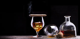 Cognac and Cigar on black with vintage table Stock Images