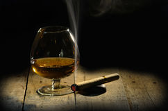 Cognac and cigar. Glass of brandy Royalty Free Stock Images