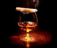 Cognac and cigar. Glass of brandy Stock Photo