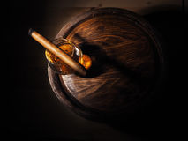 Cognac and Cigar on old oak barrel.  Royalty Free Stock Photography