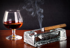 Cognac and Cigar with smoke Stock Photo