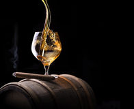 Cognac and Cigar with Smoke on black background Royalty Free Stock Photography