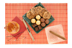Cognac, cigar and sweets Stock Photography