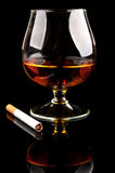 Cognac with cigarettes Royalty Free Stock Images