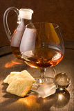 Cognac and crackers Royalty Free Stock Photo