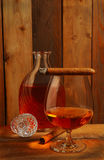 Cognac and decanter with cigar Stock Photography