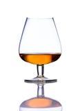 Cognac di vetro su fondo bianco Fotografia Stock