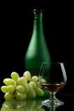 Cognac en druiven Stock Foto