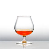 A with cognac filled snifter Stock Photos
